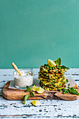 Zucchini Pea Fritter with Feta and Green Godess Dressing