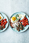 Vegetarian English breakfast with fried egg, mushrooms, tomatoes and feta