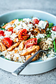 Couscous salad with chicken, braised tomatoes and feta