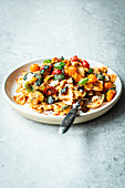 Pasta with Mediterranean summer vegetables and pesto rosso