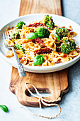 Pasta with broccoli, pesto cream sauce and sun-dried tomatoes