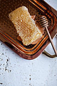 Honeycomb on a copper tray