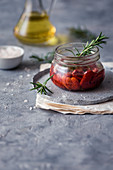 Homemade sundried tomatoes with rosemary in olive oil