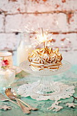 Baked Alaska cake with a sparkler