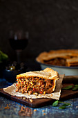 Meat pie encased in shortcrust pastry