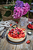 New York cheesecake with strawberries, served in the garden