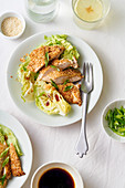Sesame chicken with lettuce wedges and honey dressing
