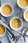 Creme caramel butterscotch pudding in a white pot