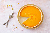 Gluten-free pumpkin tart with soy flour, cinnamon and cardamom