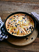 Blueberry and peach pancake bake with flaked almonds