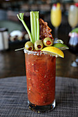 Bloody mary with olives, celery and bacon