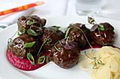 Meatballs with Berkshire pork, five spice-cider glaze, apple-beet-ginger purée and pickled fennel