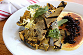 Grilled baby artichokes with black olive crumbs and zabaglione sauce