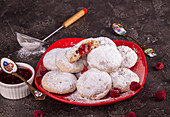 Christmas cookies biscuits snowballs covered icing sugar povder with almond nut, nutella chocolate an raspberry jam