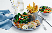 Chicken Kiev with vegetables and french fries