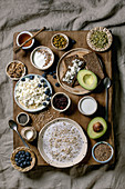 Healthy breakfast. Variety of breakfast dishes wheat, yogurt, kefir, cottage cheese, avocado, rye bread, seeds, nuts and berries assortment in ceramic bowls