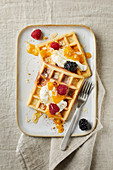 Belgian waffles with yogurt, apricot puree, flaked almonds, honey, blackberries and raspberries