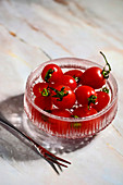 Tomatoes in a glass bowl