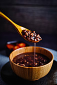 Ba bao Zhou (sweet porridge with red mung beans, China)