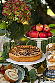 Buffet with apple pie, apple sponge roll and apple dessert in glasses