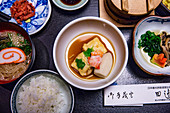 Kaiseki - light Japanese dishes with soy sauce, tofu, beef, mushrooms, fishcake and rice