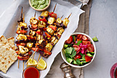 Grilled onion and pepper paneer skewers with peppermint sauce and salad