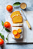 Sliced clementine pound cake and a cup of coffee on the table