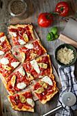Vegetarian pizza with artichokes, mozzarella, oregano and onions