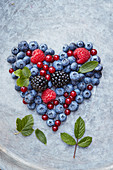Berry heart on a gray background
