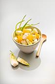 Raw salad made from sliced cimata hearts with orange