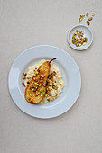 Caramelized pear on rice pudding with pistachio