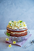 Carrot cake with cream cheese icing and edible flowers
