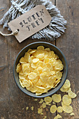 Gluten-free cornflakes in a grey bowl