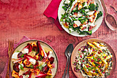 Drei verschiedene Salate (Grünkohl-Cäsarsalat, Wildreis-Taboule, Rote-Bete-Grapefruit-Salat)