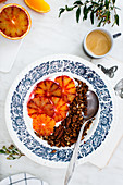 Espresso and chocolate granola bowl with yoghurt and blood oranges