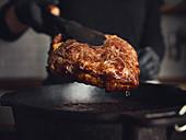 Frying a steak in a pan
