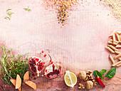 Stilleben mit Penne, Walnüssen, Süsskartoffel, Granatapfel und Reis