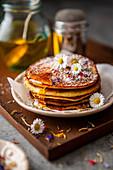 Banana pancakes with daisies