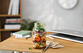 Lunch in a glass jar with steak, potatoes and vegetables