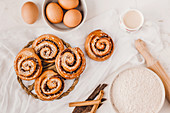 Cinnamon buns with baking ingredients