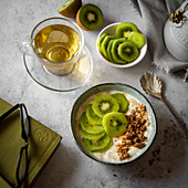 Kiwi fruit yoghurt with granola in breakfast setting