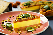 Cheesecake with quince jelly and pistachios