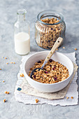 Bowl of homemade granola with plant milk