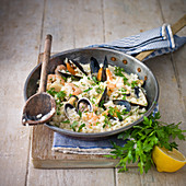 Seafood Rissotto, with prawns, mussells, clams, squid, served with lemon and parsley