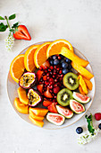 Summer fruit salad with exotic fruit and berries
