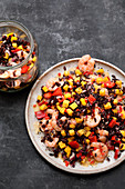 Black rice salad with mango, peppers and prawns
