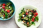 Wild herb salad with berries and mini mozzarella balls