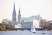 The Hamburg skyline with sailing boats in the foreground, Germany