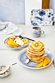 Coconut pancakes with kiwi and mango