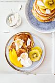 Coconut pancakes with kiwi and mango